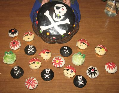 skull pirate cake with cupcakes