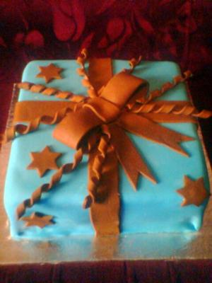 blue and brown ribbons present cake