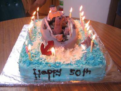 man with dog fishing cake