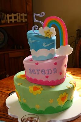 serena's care bear inspired rainbow cake