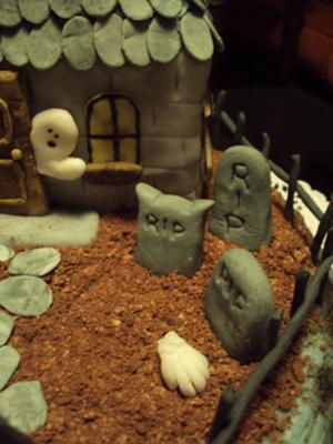 headstones on spooky mansion cake