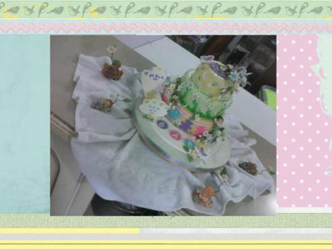 daisy and butterfly baby cake