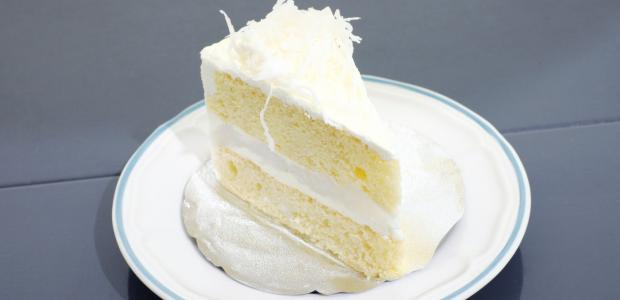 a slice of hawaiian coconut cake