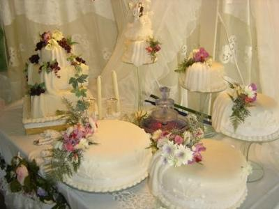 grapes and floral wedding cake