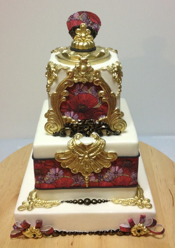 gold and poppy cake